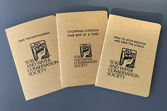 Image of three recycled paper notebooks